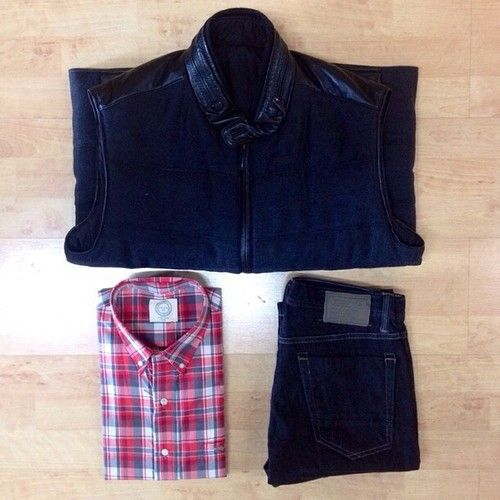 Great fall weekend look for men! This black @bugatchi_ vest over a plaid @cotton_clothing button up paired with dark wash jeans.  (at By Request for MEN )