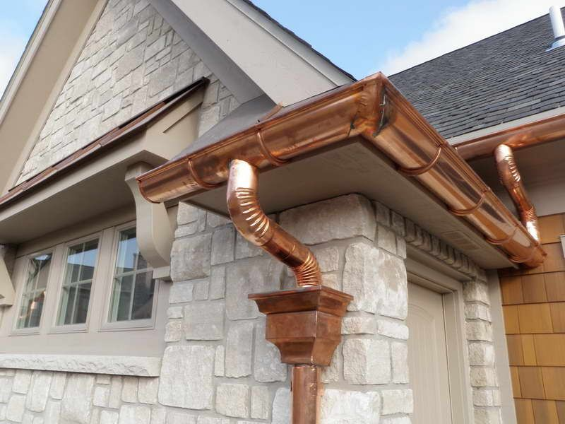 Rain Gutter Installation With Stone Wall Copper Gutters