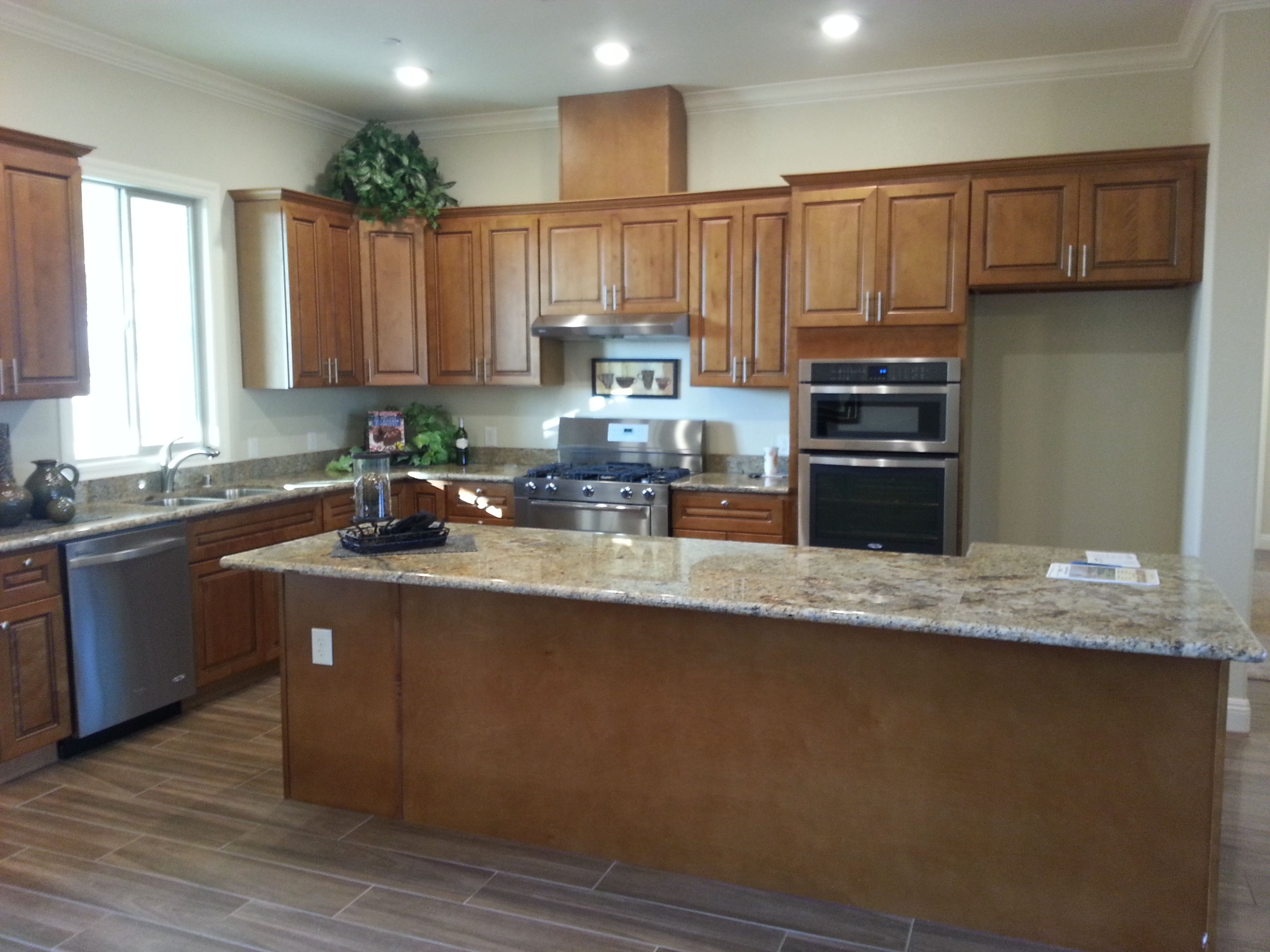 Model Home Warm Kitchen Cabinets With Granite Countertops Warm Kitchen Kitchen Cabinets Model Homes