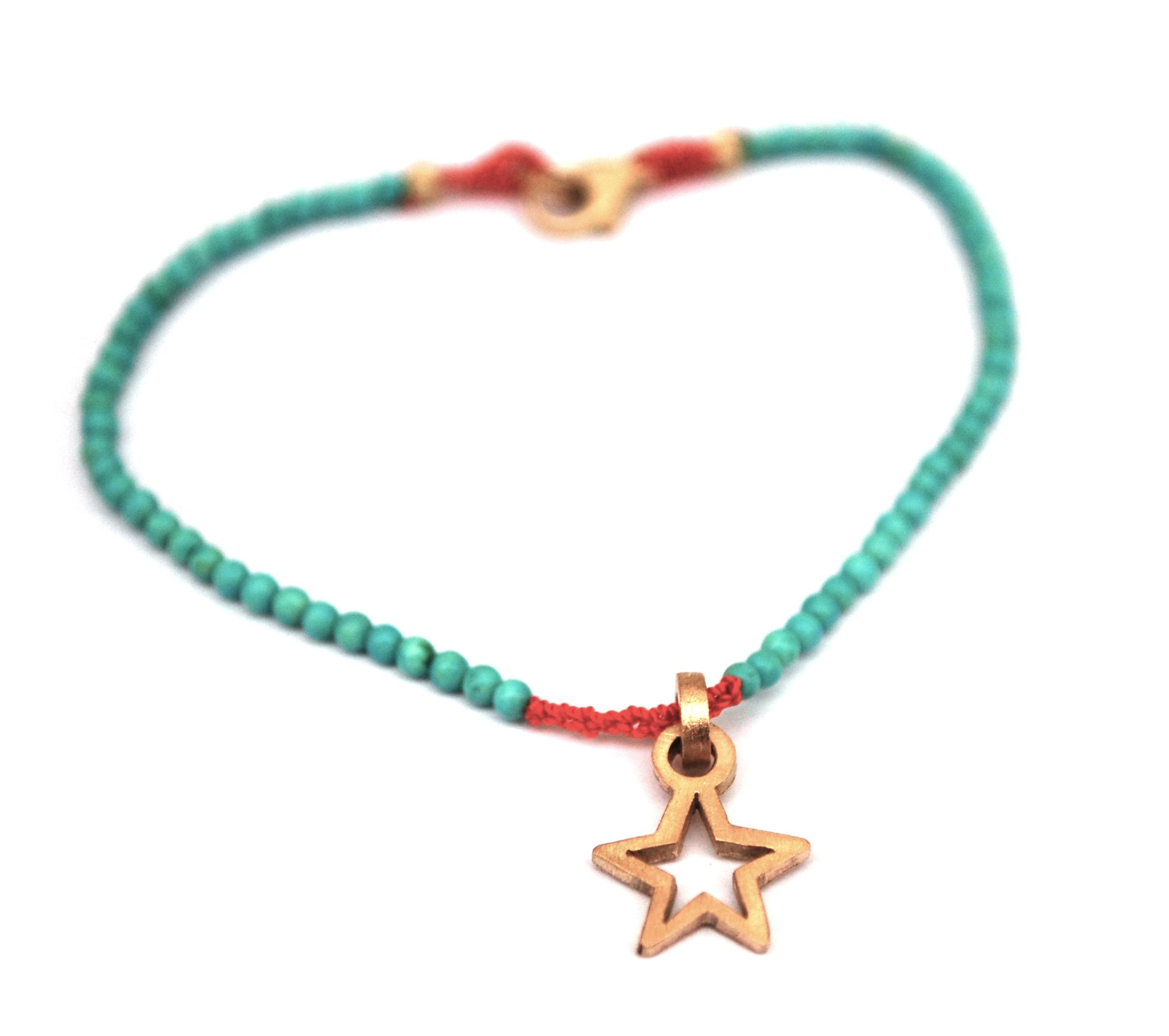 Turquoise bracelet with a star pendant made of fairtrade gold, hand made by Marije Geursen for GoLDFABRIK - Fairtrade Designer Jewelry Online Shop