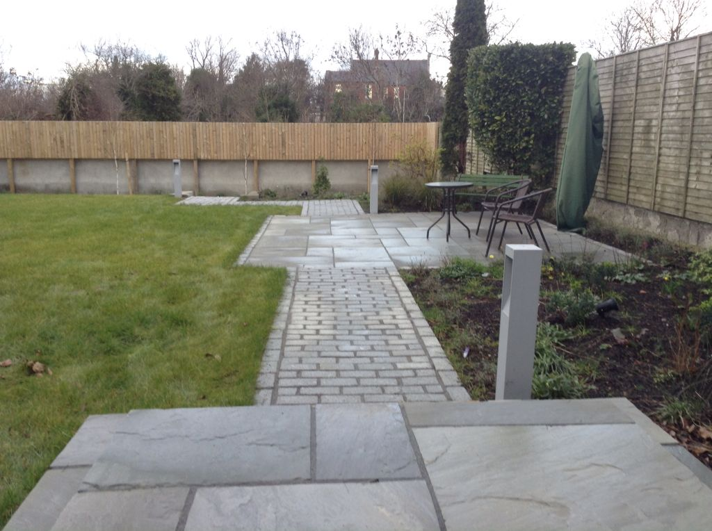 Grey sandstone patio ,with granite cobbles tumbled ,bollard