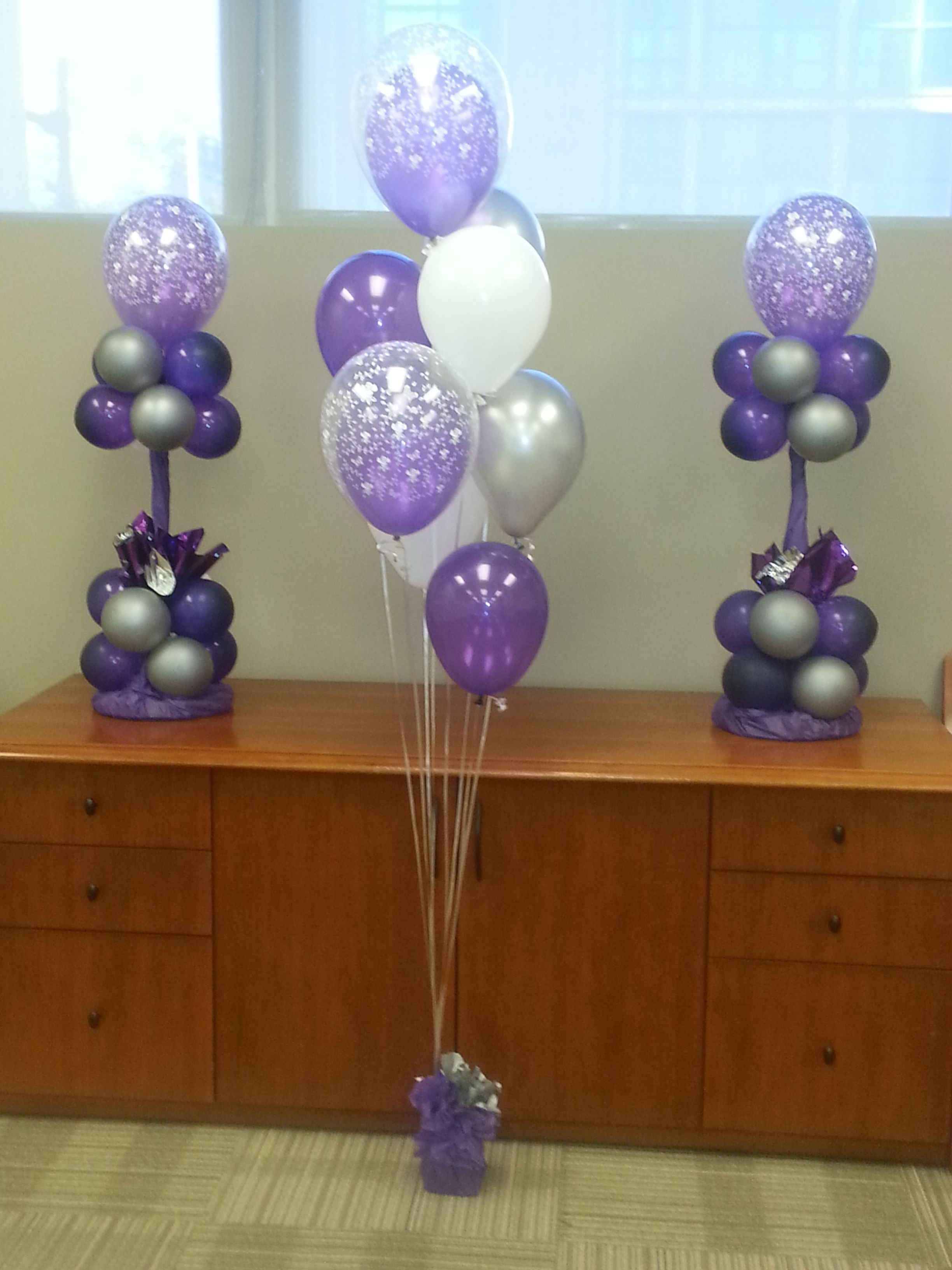Purple silver and white balloon centerpieces floor