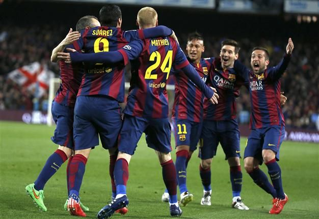Barcelona took a huge step towards a fifth La Liga title in seven years with a 2-1 win over Real Madrid thanks to Luis Suarez's stunning strike on March 23.