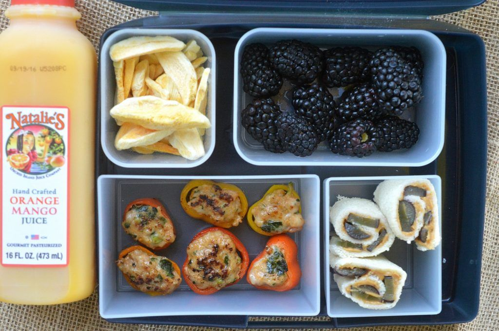Lunchbox idea for school Pepper Rings Stuffed with Chicken Sausage, PB & Grapes Roll Ups, Blackberries, Mango Chips and Natalies Juice