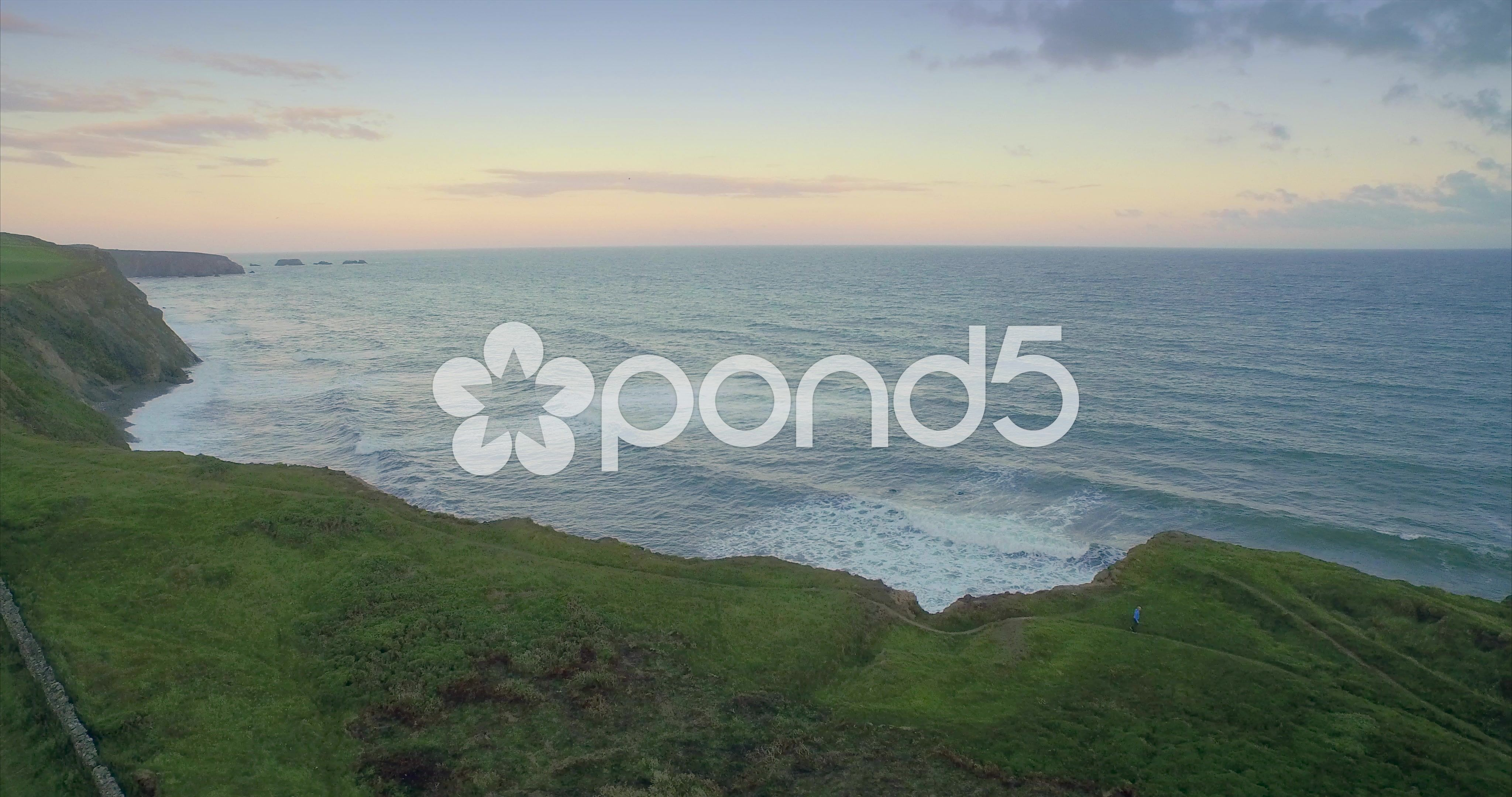 Aerial drone view of cliff edge on a stormy day sunset in