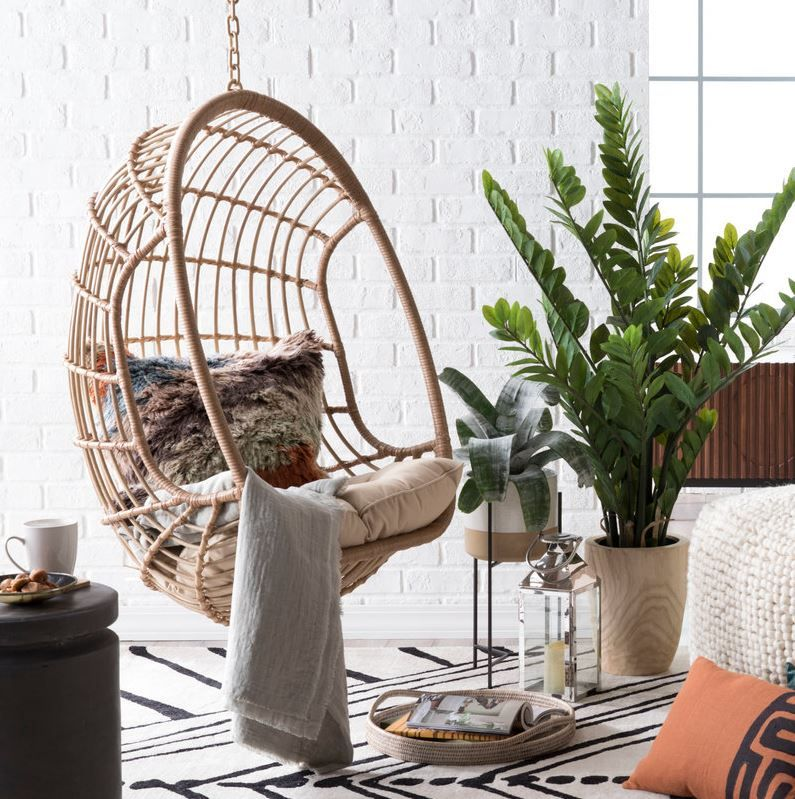 There Are So Many Reasons To Bring Outdoor Furniture Decor Indoors Practicality Durabi Hanging Egg Chair Hanging Chair Living Room Outdoor Furniture Decor