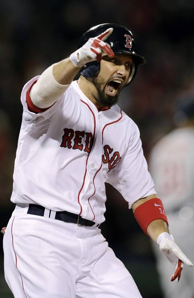 Boston Red Sox's Shane Victorino celebrates his grand slam