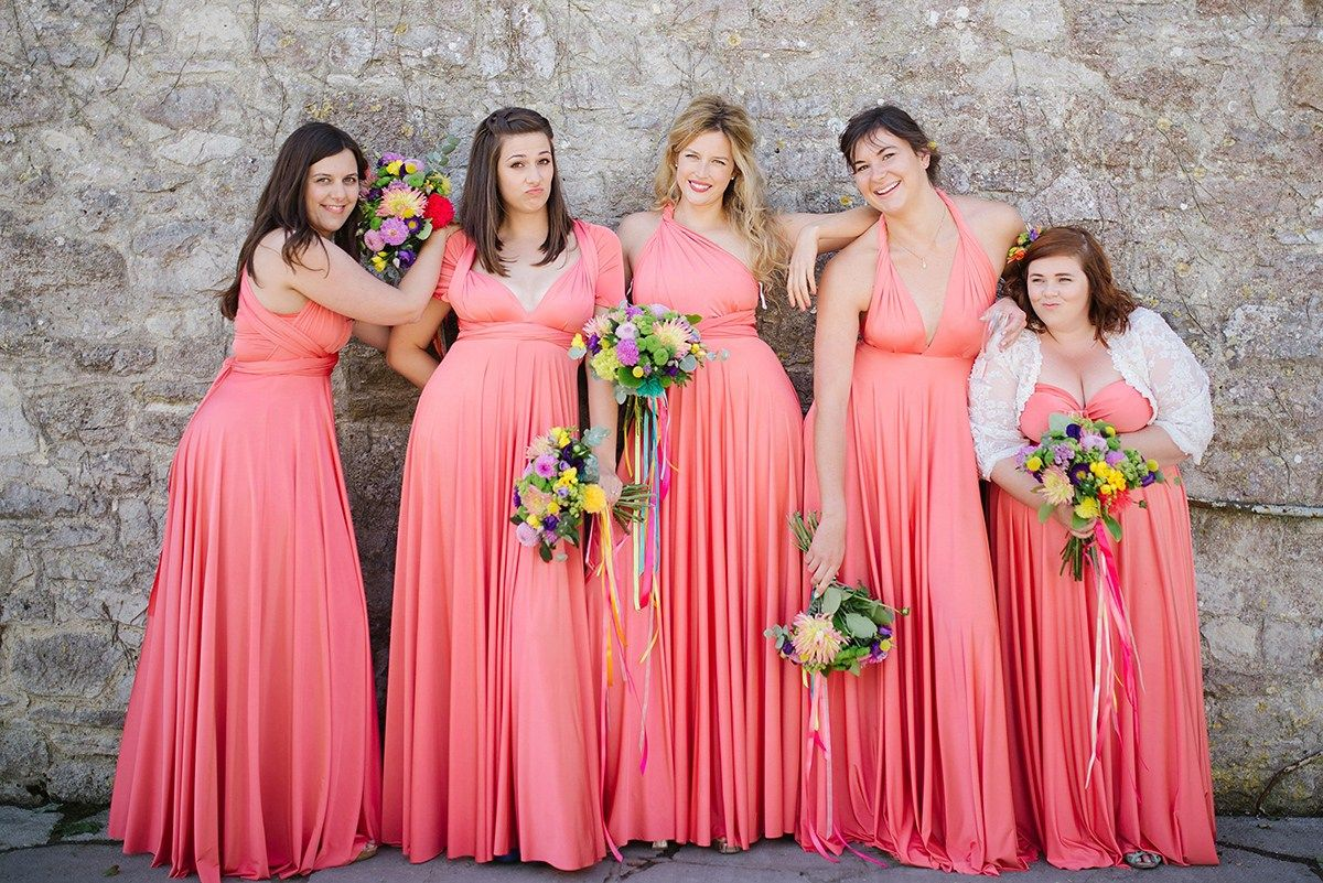 Dresses for wedding maids  A Pronovias Gown and Bridesmaids in Coral for a Vibrant Pom Pom