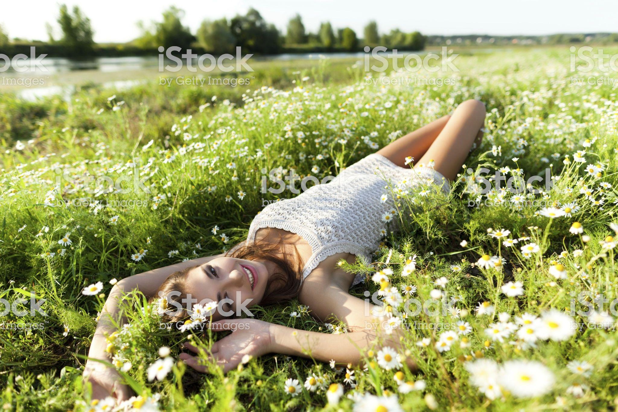Beautiful woman portrait in flowers field