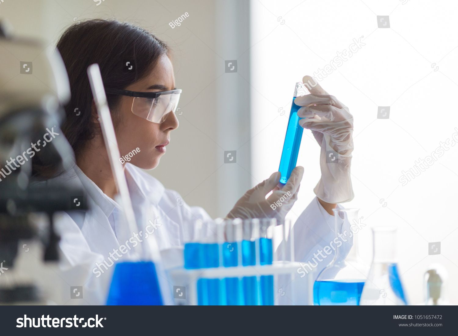 Pharmacist at manufacture on pharmaceutical factory for