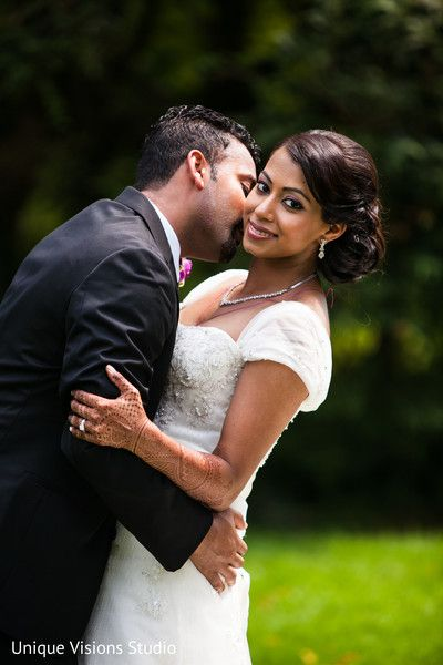 An Indian Bride And Groom Pose For Classy Wedding Portraits