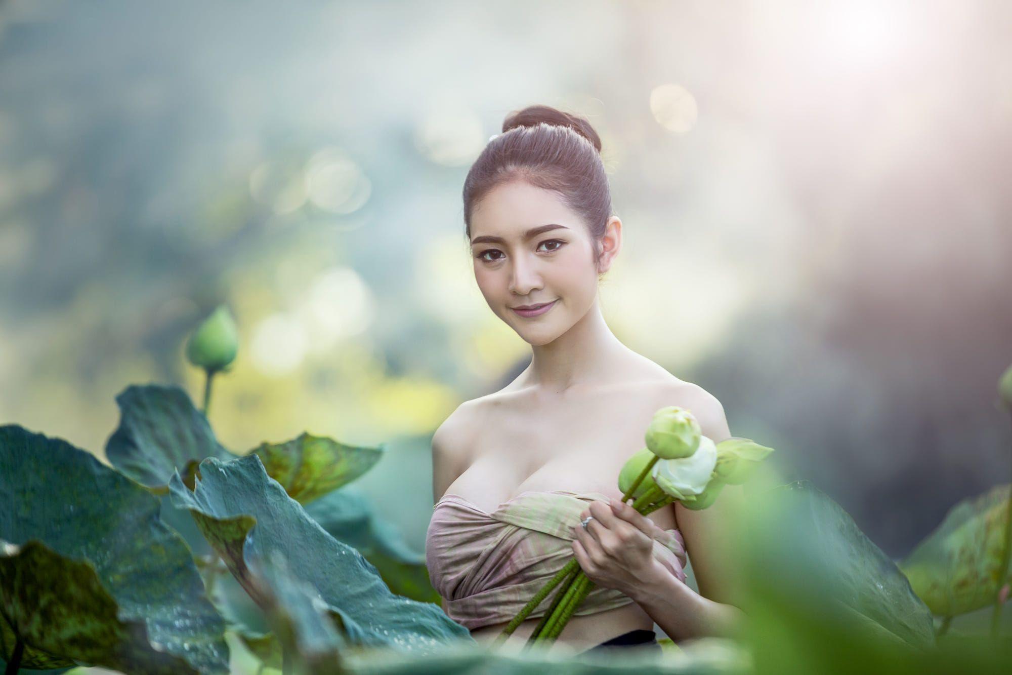 Asian woman harvest lotus flower by Sasin Tipchai on 500px