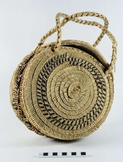 "According to Pacific artist Rosanna Raymond this ""Tongan handbag reflects modern innovation from traditional basket-making and plaiting or rope making techniques. This style has gone out of fashion but you still see them being made today, this is a great example which would have been made for the tourist trade but no doubt the locals would have loved it as well, it is very well constructed and made from pandanus."""