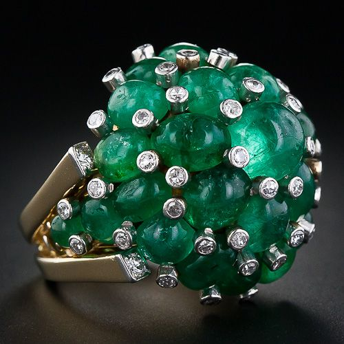 shimmering clusters of bright green cabochon emeralds dotted with tiny diamond sparklers in between