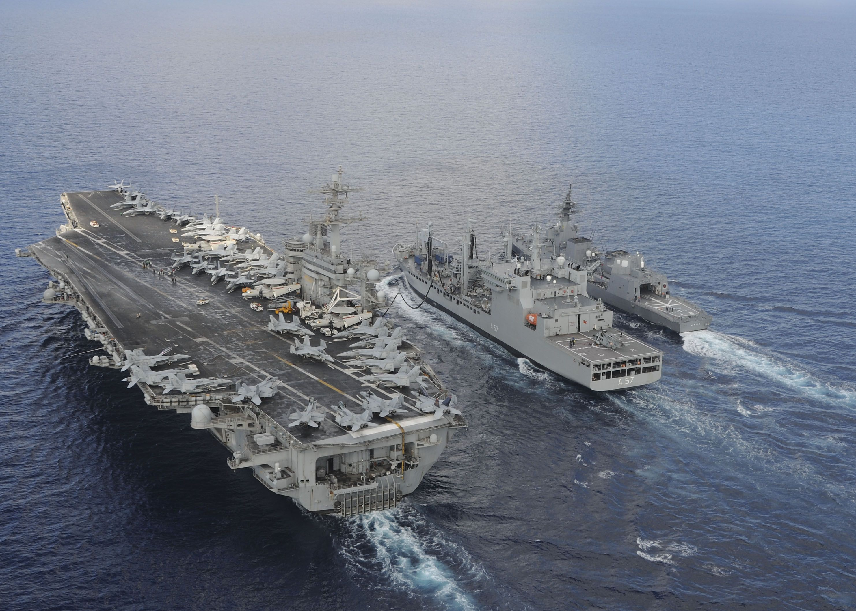 INDIAN OCEAN,Oct.18,2015.Aircraft carrier USS Theodore Roosevelt (CVN 71) & Japanese Maritime Self-defense Force Akizuki-class destroyer JS Fuyuzuki (DD-118) sail alongside Indian Deepak-class fleet tanker INS Shakti (A 57) during replenishment-at-sea exercise as part of Exercise Malabar 2015.Malabar continuing series of complex,high-end war fighting exercises conducted to advance multi-national maritime relationships & mutual security.USS Theodore Roosevelt (CVN 71) operating in US 7th AOR.