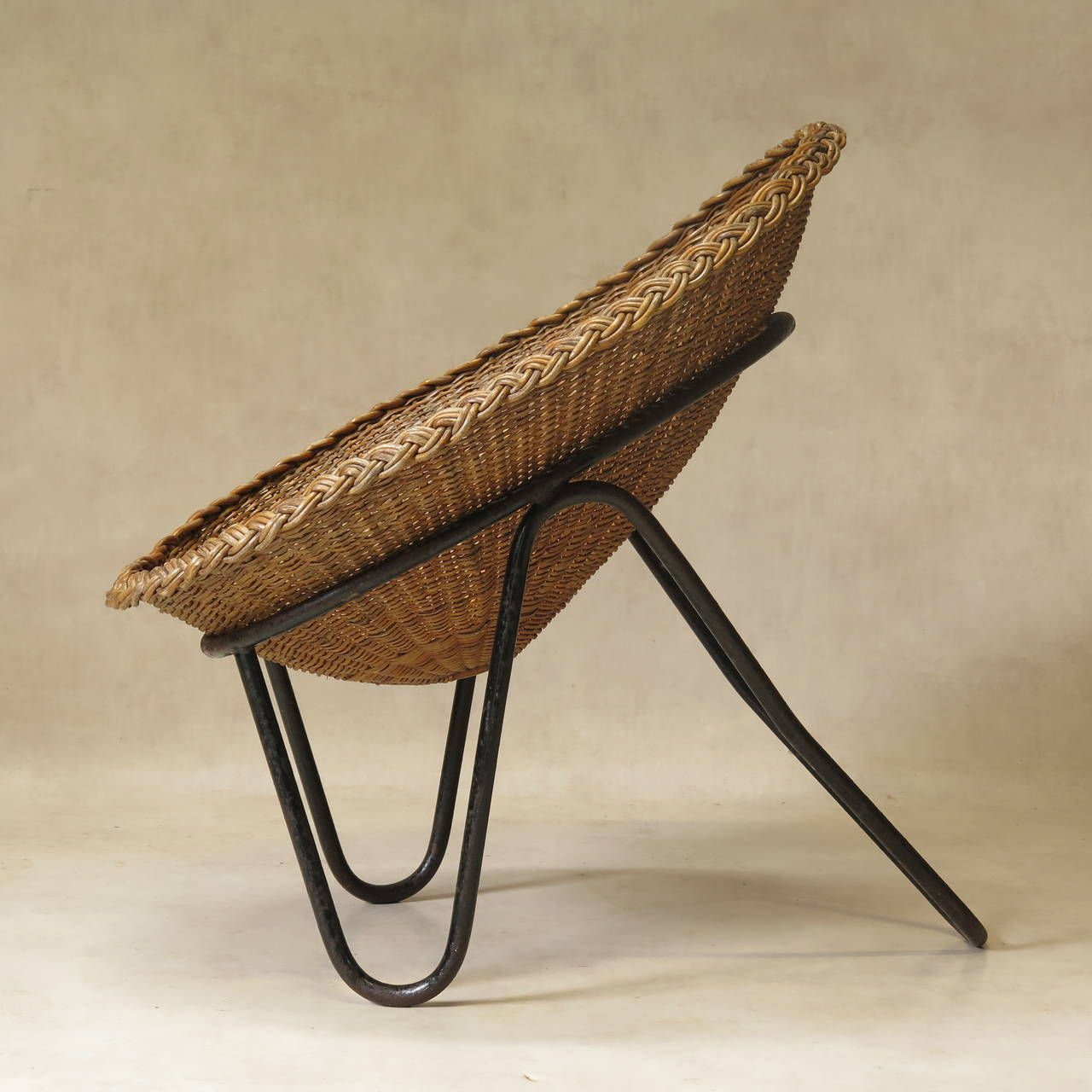 2012 HEIGHT:35.04 in. (89 cm) WIDTH:27.56 in. (70 cm) DEPTH:35.43 in. (90 cm) SEAT HEIGHT:15.75 in. (40 cm) Pair of Wicker and Iron Lounge Chairs, France, 1950s ( 3 Pairs Available ) | From a unique collection of antique and modern lounge chairs at https://www.1stdibs.com/furniture/seating/lounge-chairs/