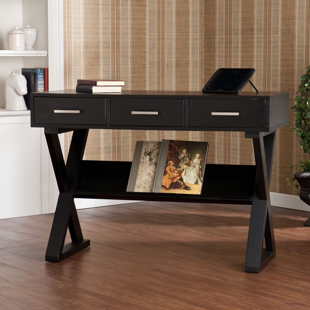The Cressford Writing Office Desk Features A Black Finish With Subtle Grain  And Silver Drawer Handles On Its Three Drawers. The Support Bar Beneath The  Desk ...