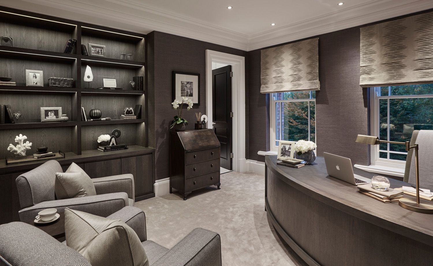 an ultra modern home office with a black wall and a glass