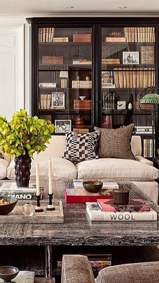 Living Room With Books: Glass Front Bookcase, Cushy Linen Sofa, Big Coffee Table