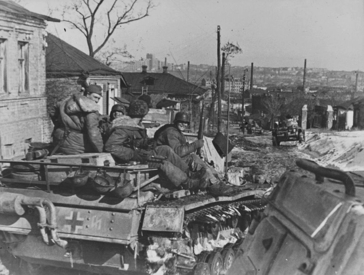 With downtown kharkov looming in the far distance panzers and m from ss panzer grenadier division das reich are reentering in the city buycottarizona