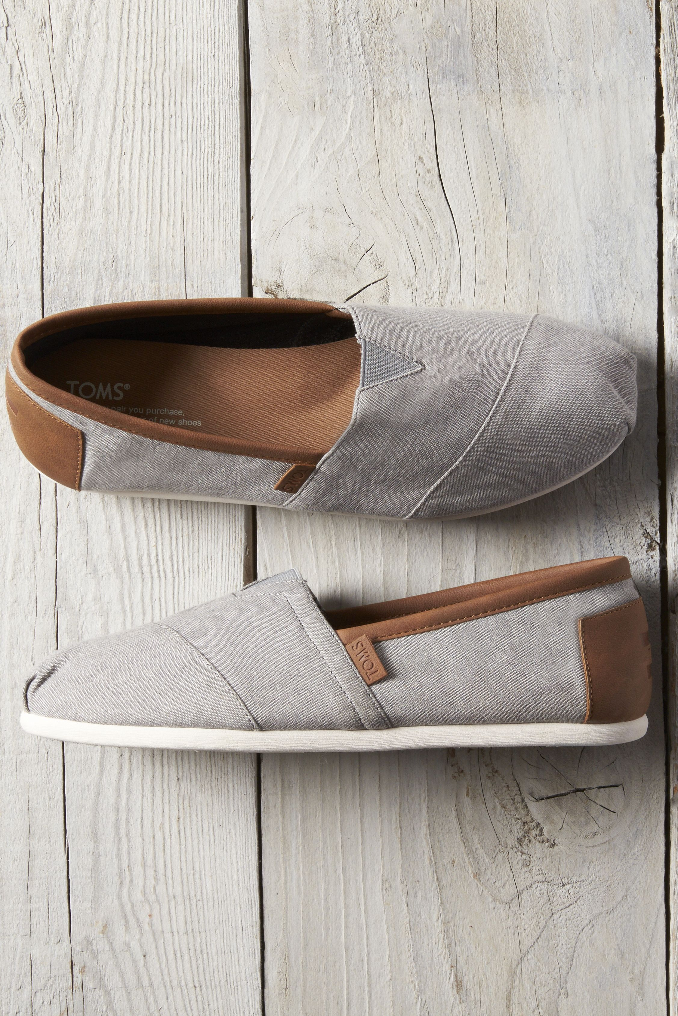 info for c436a 89182 Frost Grey Chambray Men s TOMS Classics for comfort and style. These  slip-on shoes have a molded footbed for extra cushioning and are made from  grey ...