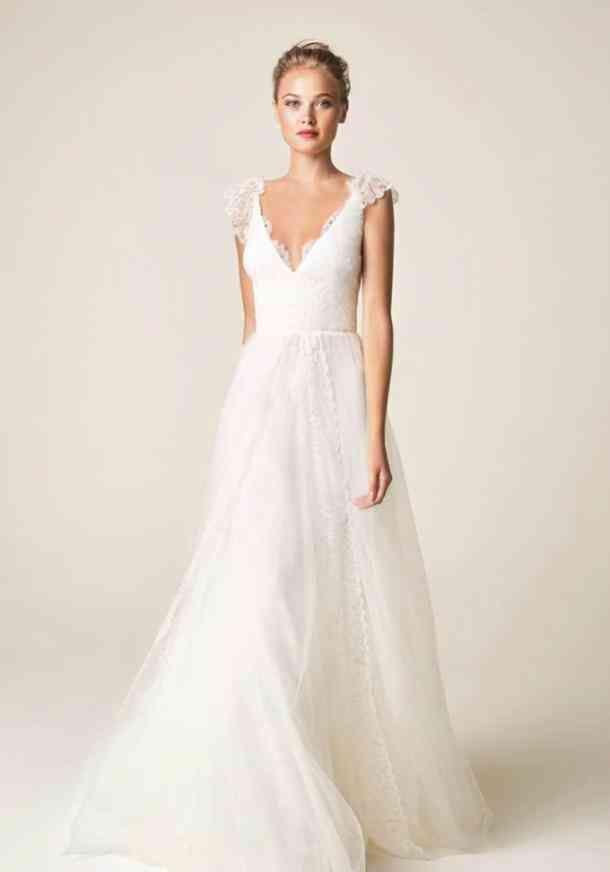 30 Best Lace Wedding Dresses Of All Time Jesús Peiró V-Neck Cap Sleeve Wedding Dress Scalloped eyelash lace romances