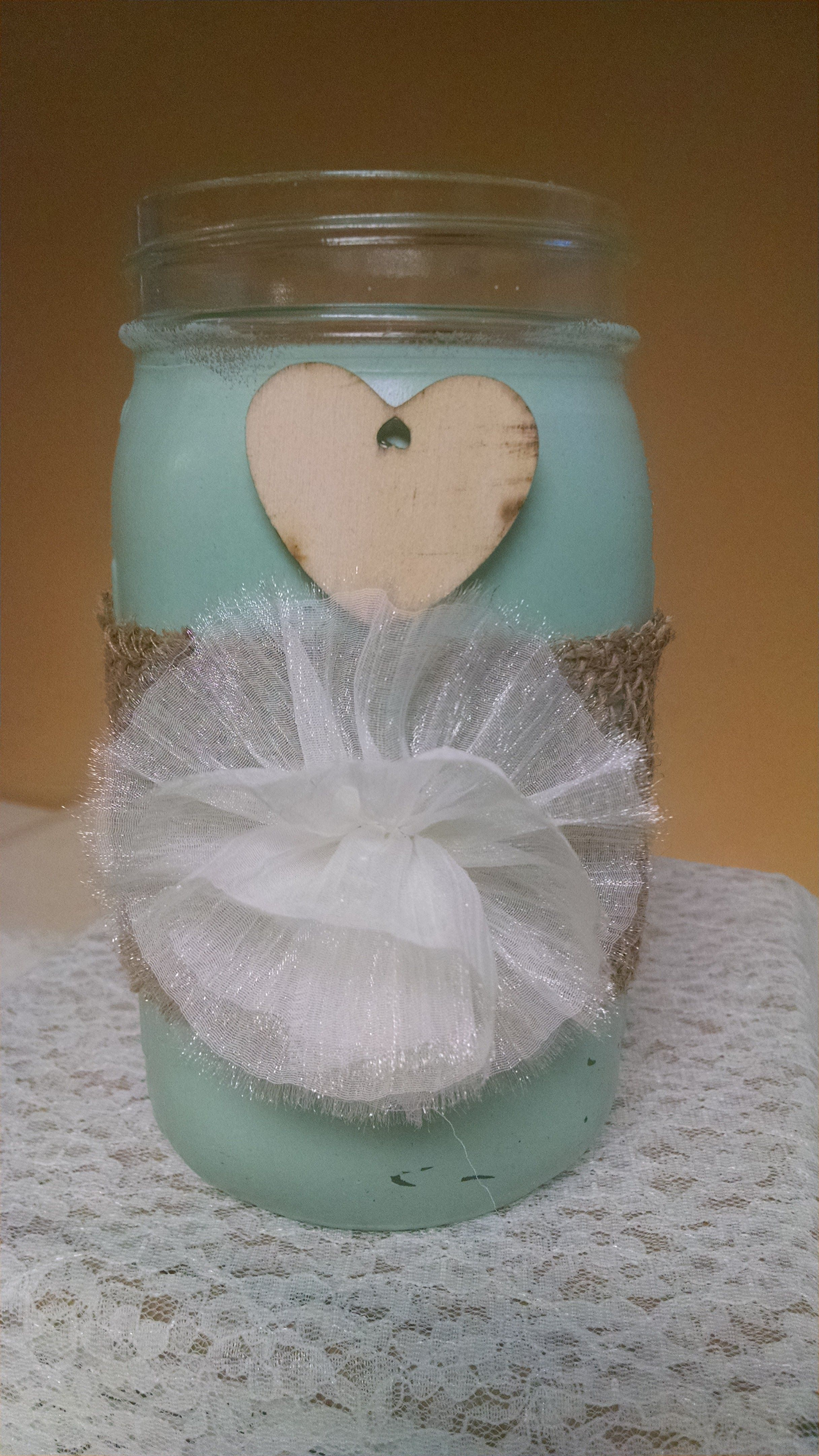 Mason Jar chalk painted with Dixie Belle's Sea Glass, added a bit of burlap, silky flower and a little heart.  www.decoupagedesignsusa.com #decoupage