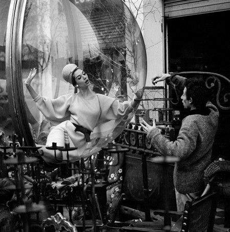 Photographer Melvin Sokolsky working with a model, Paris, 1963
