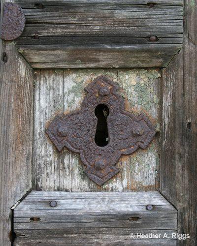 Rusty Keyhole op een houten deur, fotograferen