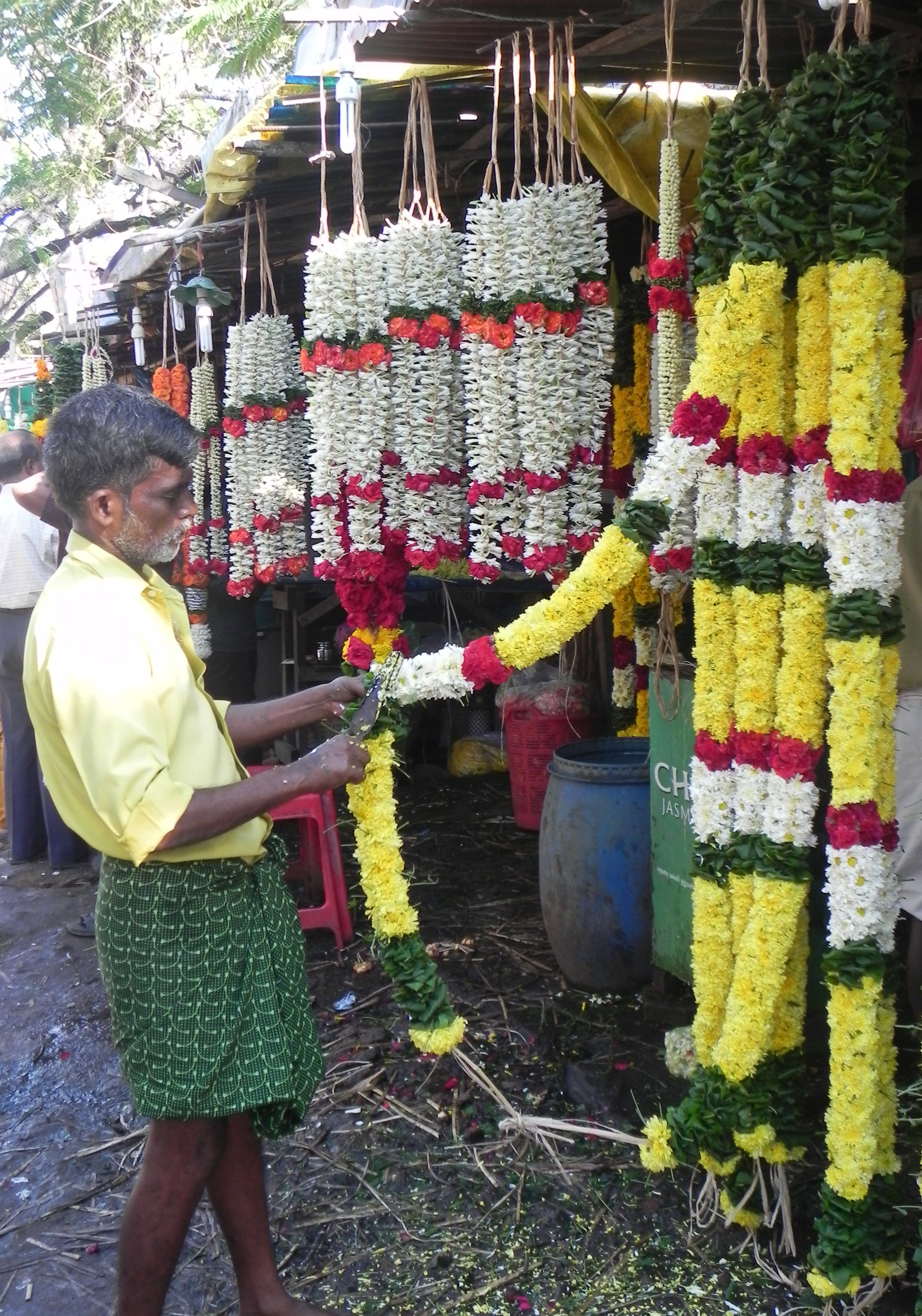 Man trimming his Flower garlands, Chennai, India | At the Market ...