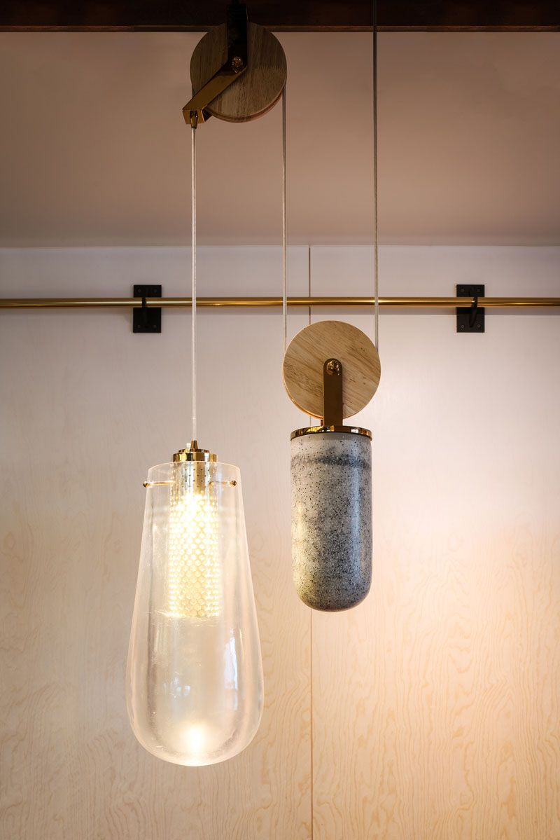 The Custom Designed Pendant Lights That Are On A Pulley System