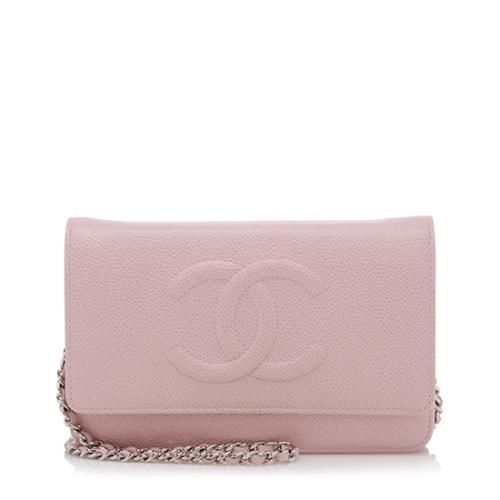 e60ae7592ba5 This iconic Chanel Wallet on Chain (WOC) bag is made from light pink caviar…