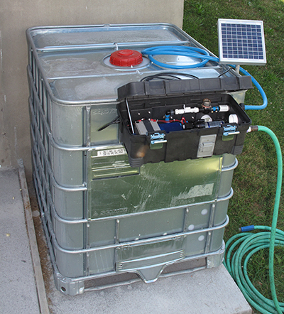 Renewable Energy Home Solar Powered Water Pump Water Barrel Water Conservation
