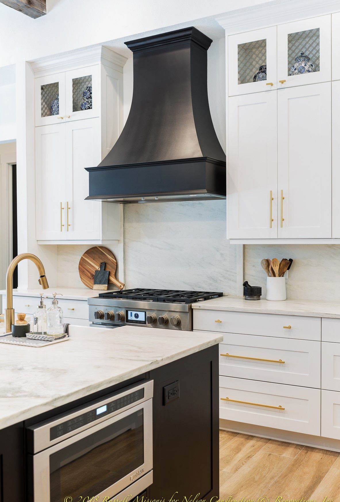 Love The Black Hood And Brass Fixtures In This Kitchen We Remodeled In Brandon Florida Last Year Kitchen Hood Design Kitchen Range Hood Kitchen Remodel
