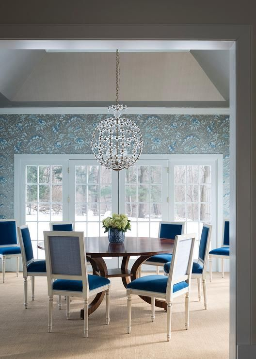 Stunning Dining Room Features A Vaulted Ceiling Accented With An Iron Orb Chandelier Crystal