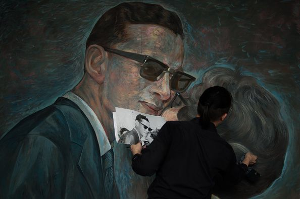 Thai artists and alumni of Silpakorn University paint a portrait of Thailand's late King Bhumibol Adulyadej at the university in Bangkok Thailand on...