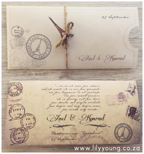 Vintage Travel Inspired Wedding Invitation with stamps and wood embellishment of eiffel tower