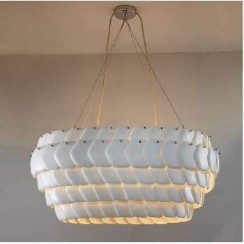 Are you looking for a light to make an impact? This could be the one for you! Highly decorative and with an impressive stature, this makes a style statement that cannot be missed!   Handmade in the UK, the shade is made from overlapping hexagonal shaped fine bone china discs. This ensures that it is eye catching when not in use, but when illuminated it comes alive with playful shadows and texture whilst emitting a warm, ambient light.   Suspended on wire and a sand and taupe braided cable…