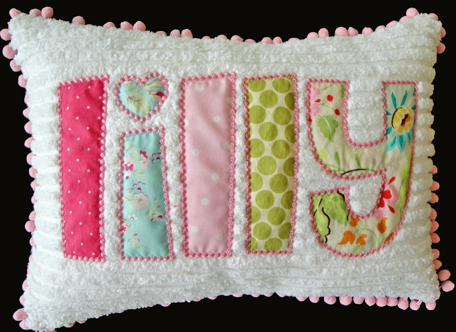 Appliqued name on chenille pillow with pompom trim so cute not