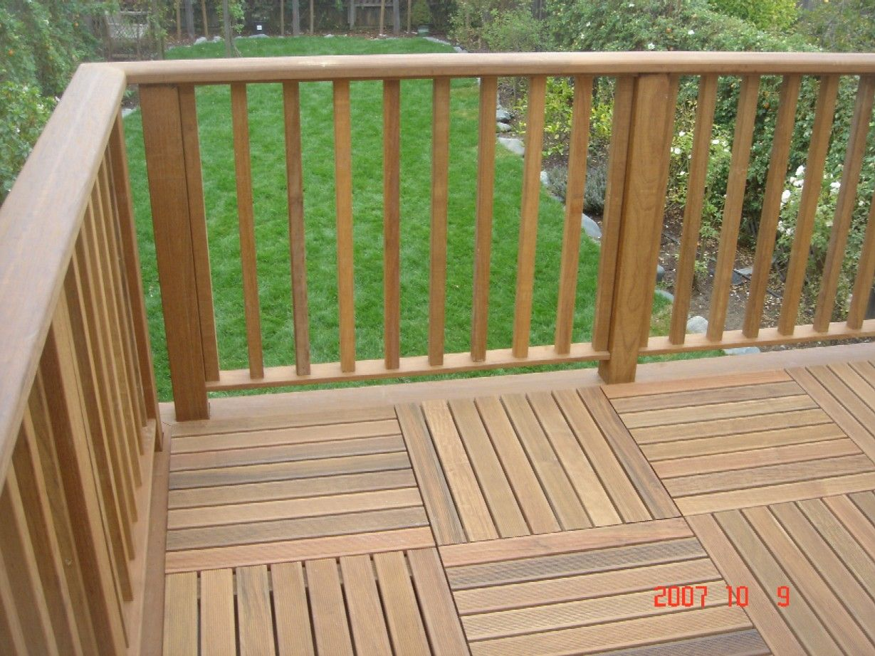 Deck railing ideas iron wood railing garden for Garden decking banister