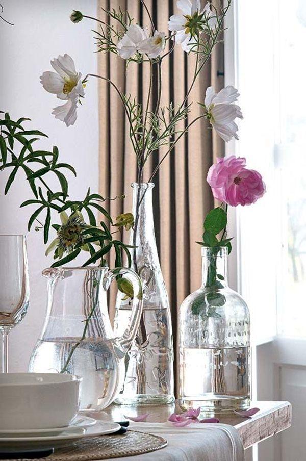 Decora con botellas de cristal y flores floreros casero - Decoracion jarrones cristal ...