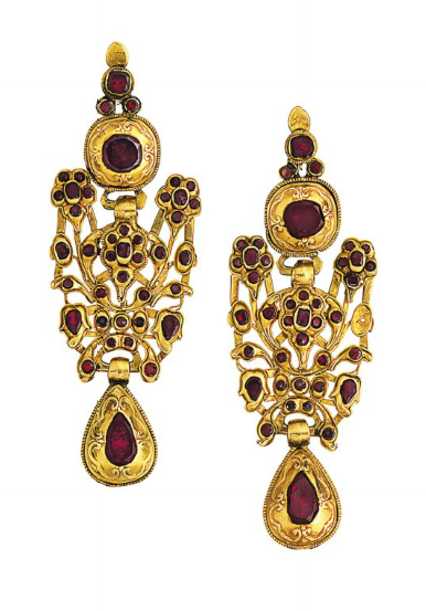 A pair of late 18th century Catalan gold and garnet earrings  Each navette-shaped earpendant composed of three articulated sections set throughout with vari-shaped foiled garnets, the mounts with raised repoussé style decoration, circa 1780, 9.0cm long