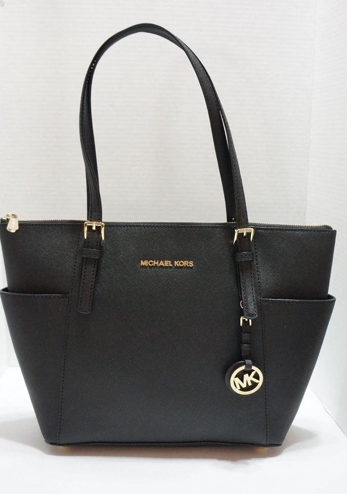 cd3888836 Michael Kors Jet Set East West Top Zip Leather Tote Gold Black  138.99  http