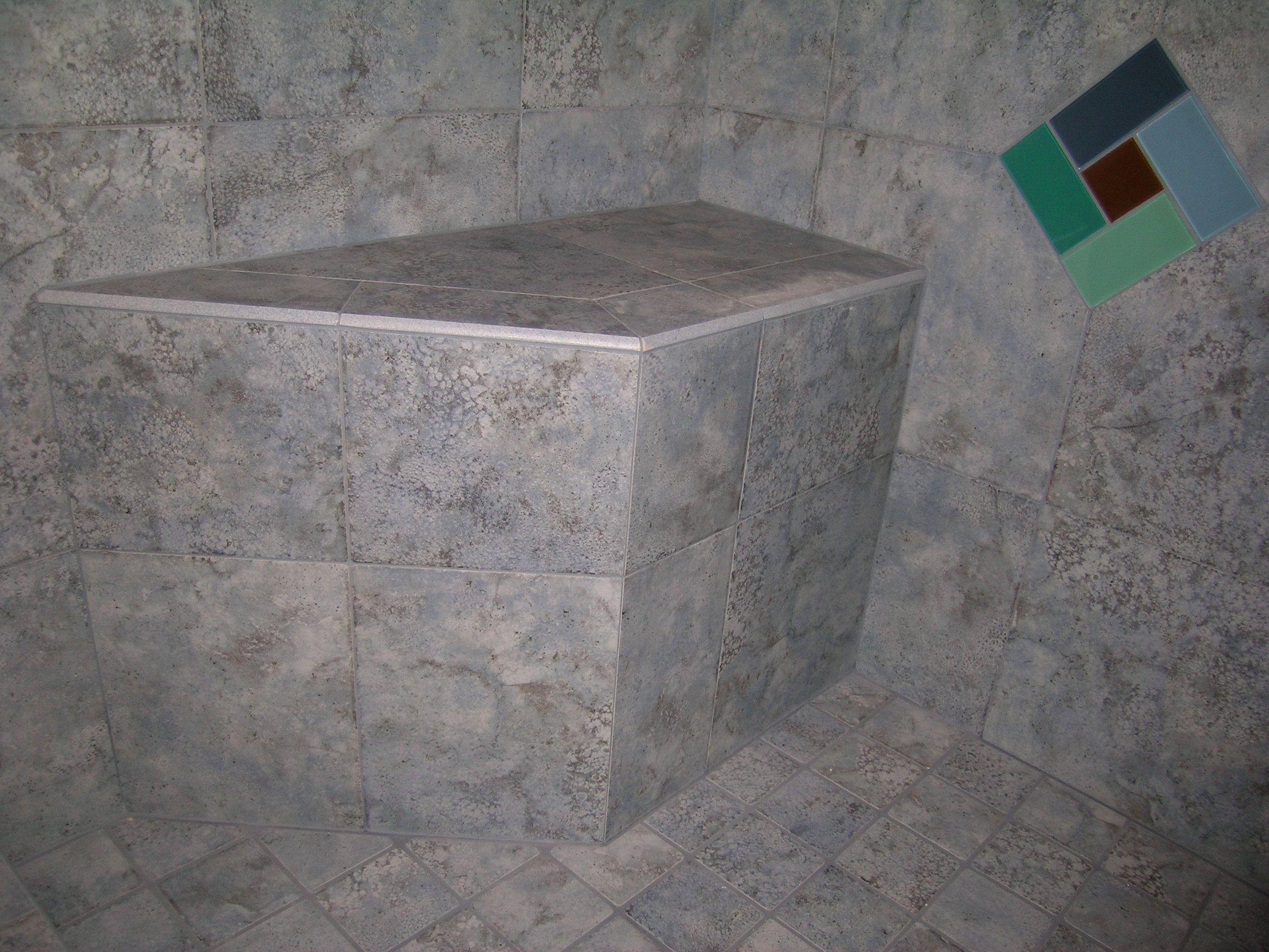 porcelain tile shower seat and glass tile pinwheel insert