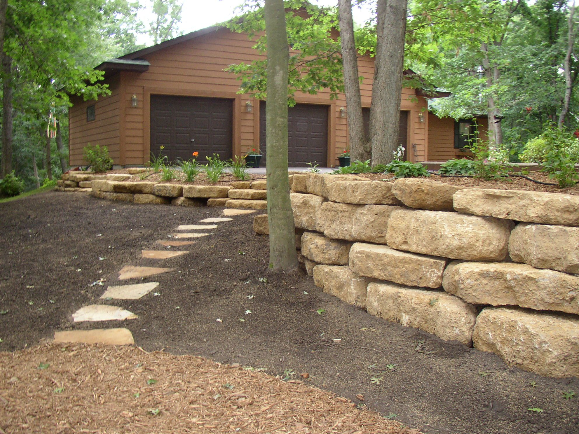 Retaining Walls Modular Block Natural Stone And Boulders Environmentallandscapes Landscaping Retaining Walls Stone Landscaping Large Backyard Landscaping