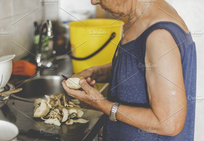 Old Woman Peeling Potatoes. People Photos. $5.00
