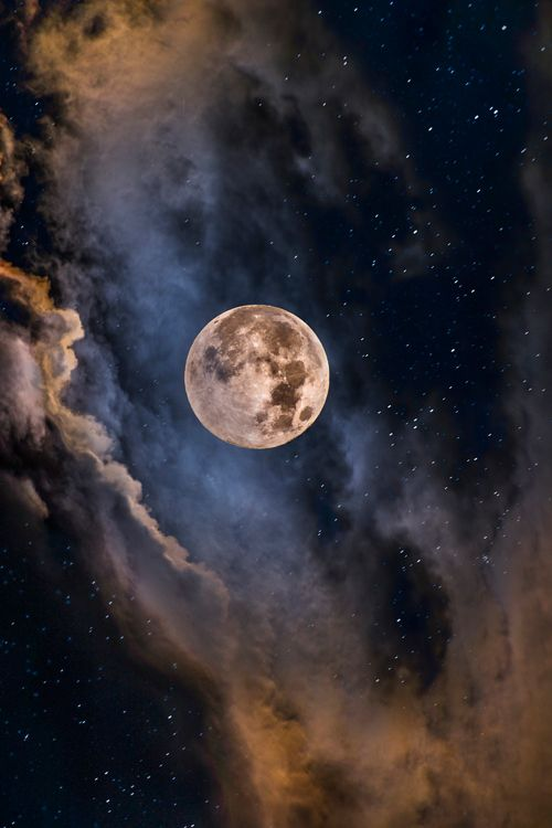 Full moon bathed in clouds. #astronomy #moon