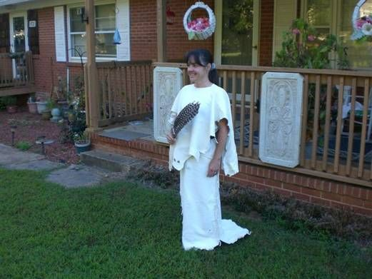 This is a 2 piece set that includes a sundress style dress with matching cape/yoke...Made of bucksin for Daphni McDaniel Whisenhunt of North Carolina.