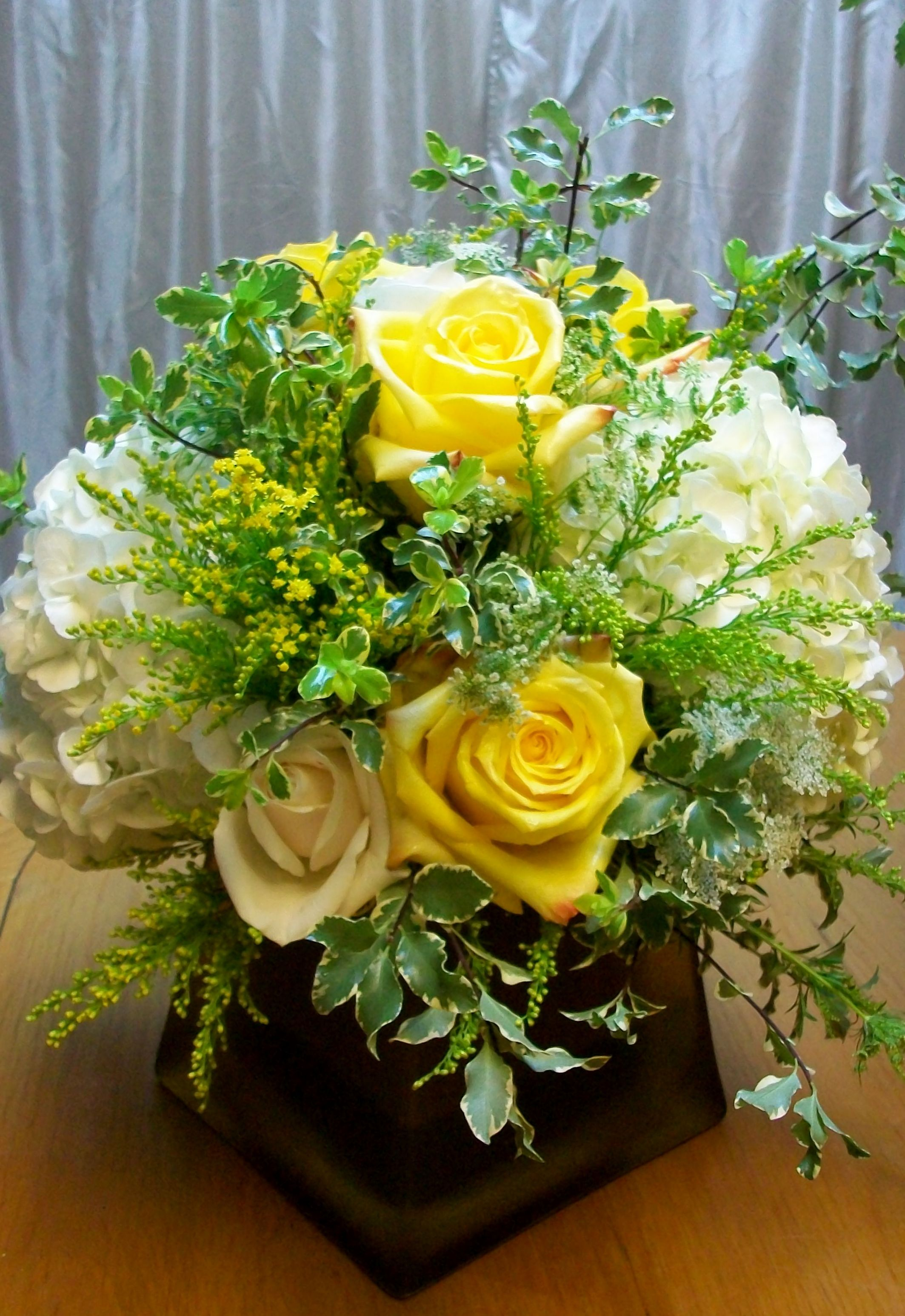Low centerpiece yellow rose white hydrangea square gold