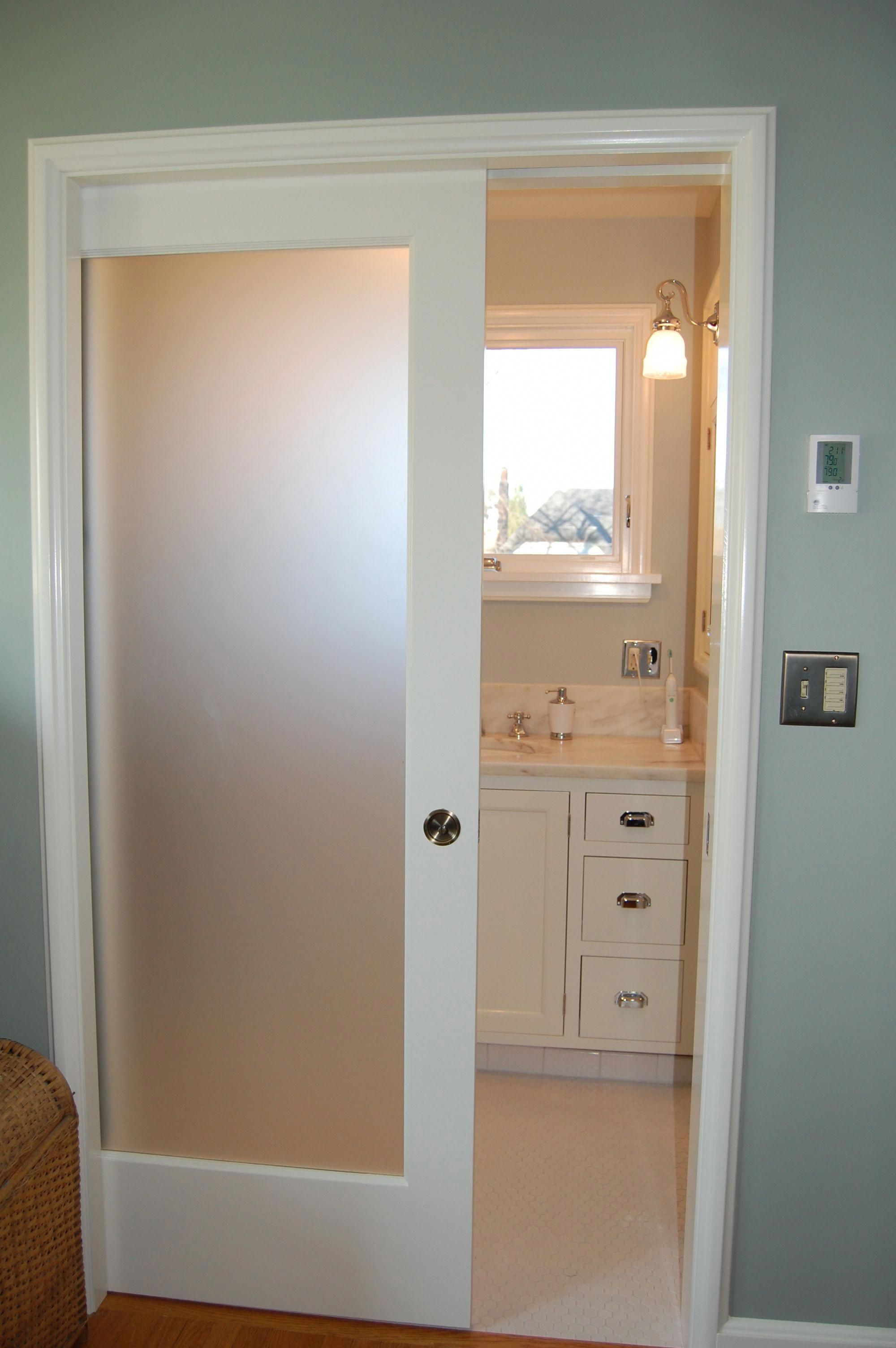 Pocket door with frosted glass this reminds me of my bathroom when i lived in my apartments